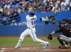 Jun 19, 2015; Toronto, Ontario, CAN; Toronto Blue Jays first baseman Justin Smoak (14) hits an RBI single in the first inning against the Baltimore Orioles at Rogers Centre. Mandatory Credit: John E. Sokolowski-USA TODAY Sports