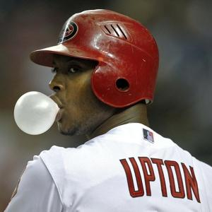 Justin Upton, lackadaisically chewing gum.